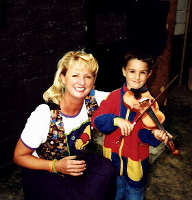 Cindy Cook visits with a young violinist after a show